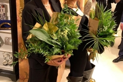 Vera Brezhneva and Maria Fedorova with elegant bouquets from the leaves of Ruscus, aspidistra, umbrella, asparagus, monstery and palm trees.