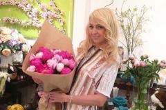 Yana Rudkovskaya with a wonderful bouquet of peonies.