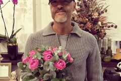 Fyodor Bondarchuk with a romantic bouquet of Bush roses and eucalyptus.