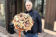 Valery Meladze with a delightful bouquet of green roses, spray roses, carnations, matiolli and Veronica.